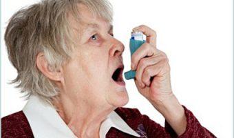 old woman using an inhaler