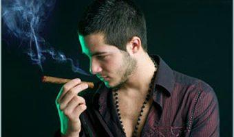 attractive man smoking a cigar